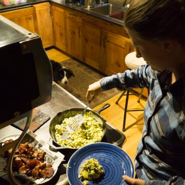 Sabina serves up some human food as the Opus Hut Pup waits for her serving. (Photo Sarah Zoey Sturm)